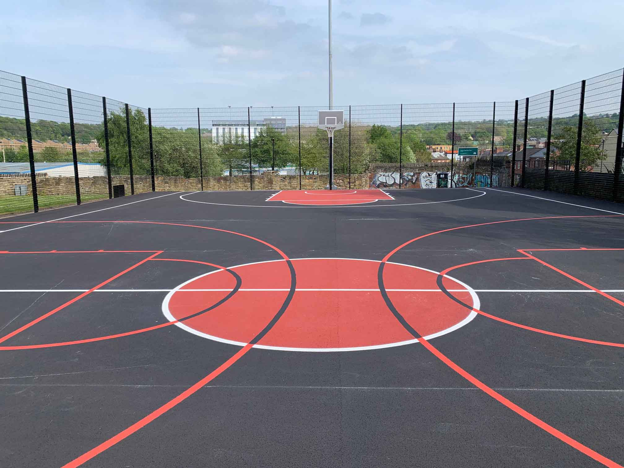 Empty Basketball Court with Basketball Theme Markings